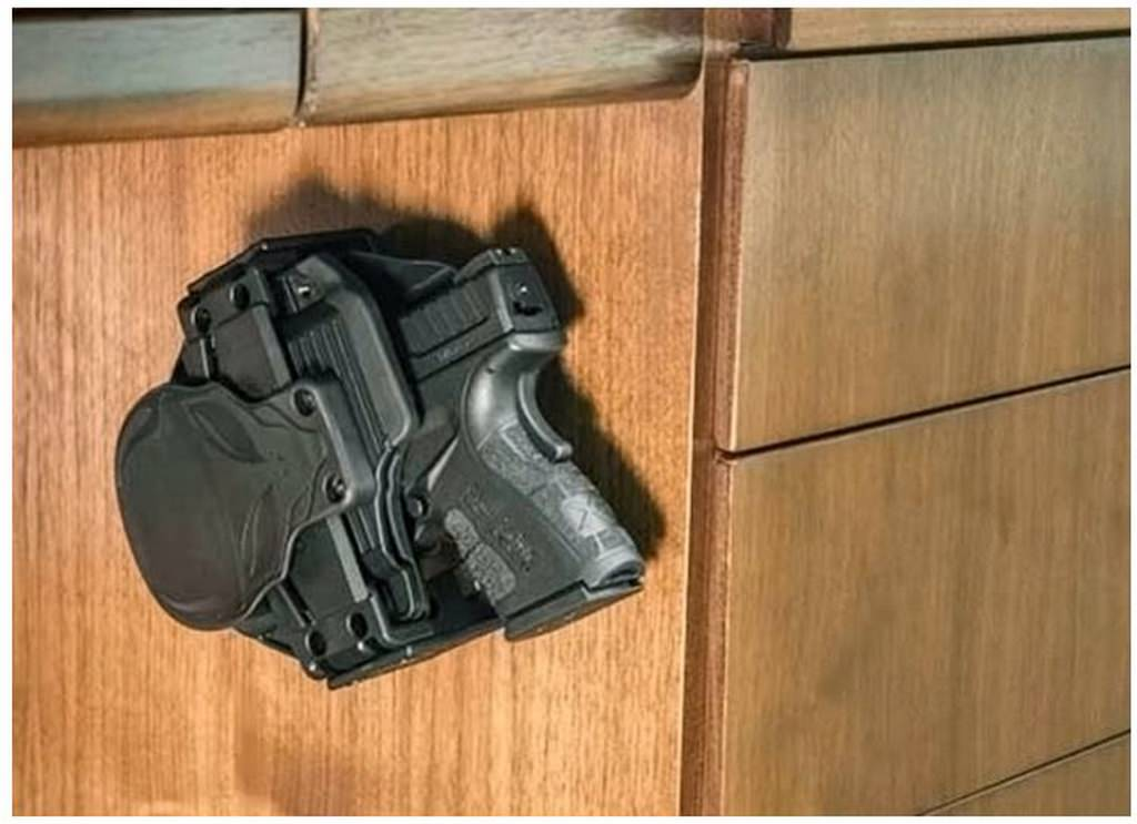 Cloak Mod OWB Holster and Gun Fits in the Cloak Dock Mounting Bracket Attached to Desk
