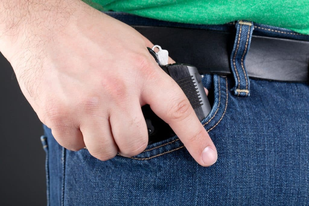 Man Pulling Gun Out Of Pocket