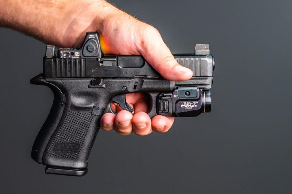 Handing a Gun to Someone