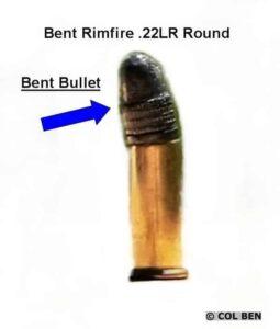 Bent bullet or bent case.