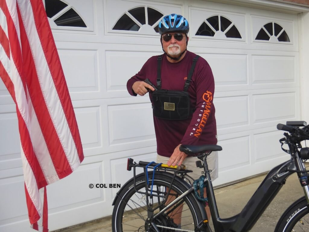 Author Using Chest Bag for Concealed Handgun Carry with Hammer Strapped to Rear Cargo Frame